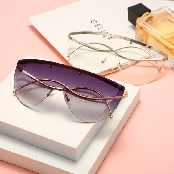Oversized-Women-Sunglasses-2020-Fashion-Metal-Curved-Half-Rimless-Sunglasses-Men-Women-Big-Frames-Goggles-Shades-3.jpg